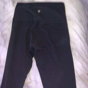 old worn out black lulu lemon leggings